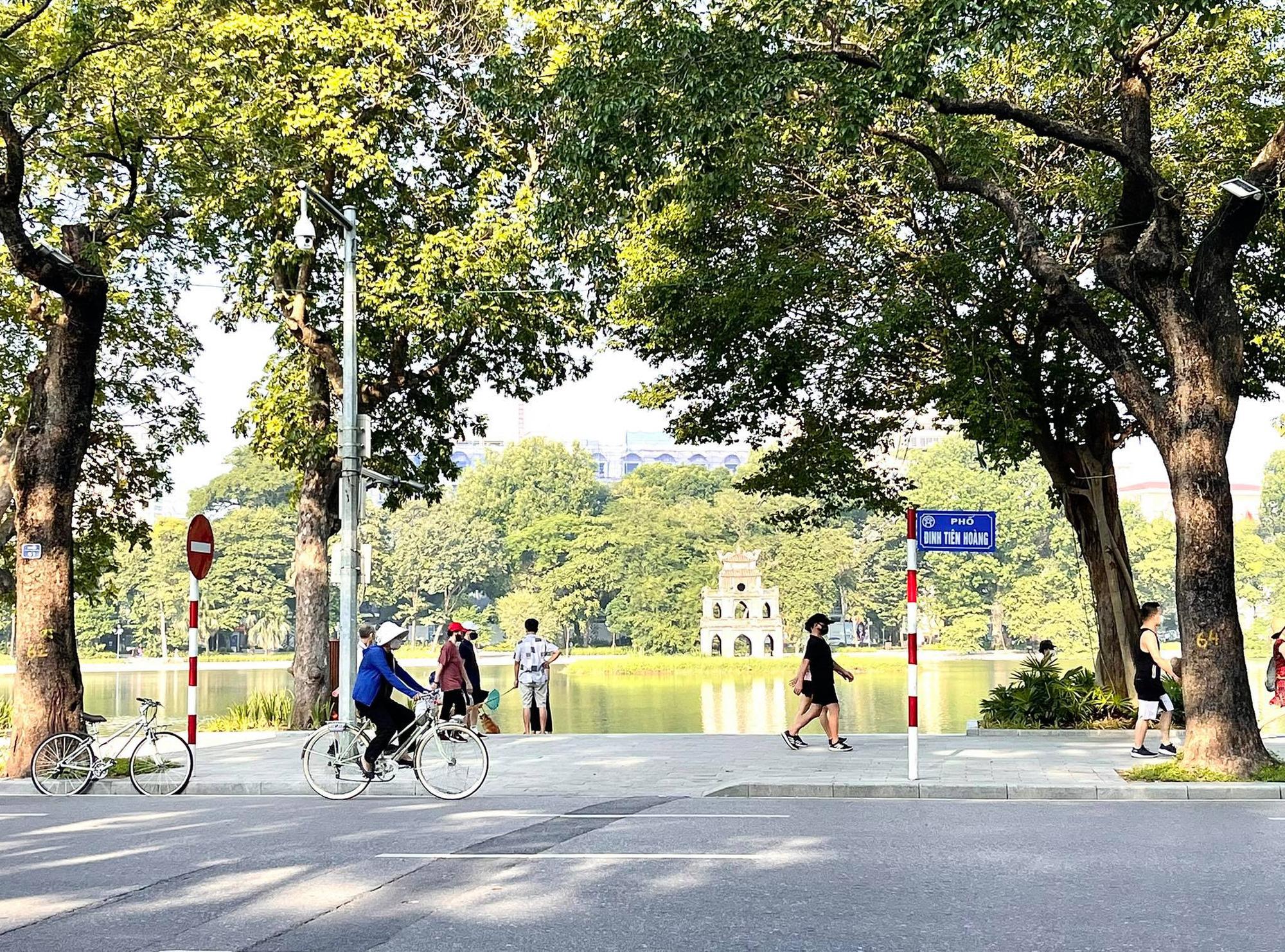 Hà Nội cho phép nhiều hoạt động trở lại từ 6h00 ngày 14/10 - Ảnh 1.